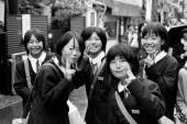 group-of-japanese-schoolgirls-holding-up-two-fingers.jpg