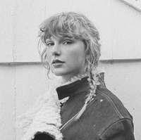 Taylor-Swift-Evermore-Press-3.jpg